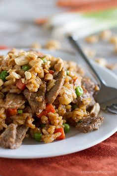 This Asian-inspired Rice and Beef Stir Fry Recipe has rice, beef, vegetables and a homemade stir fry sauce that combine to form a comforting dinner filled with flavor.