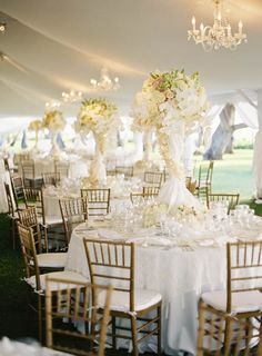 Lavish white natural tables for the wedding reception. But needs a pop of color! :)
