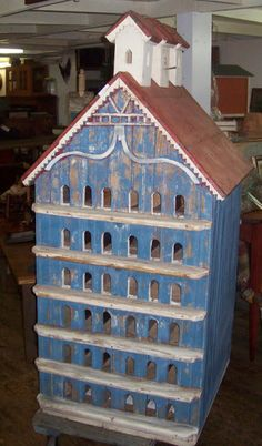 old blue painted...red roof bird home....