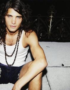 Adam Wallace. I love his hair. He's unusual.