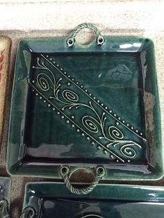 Handmade ceramic slab platter in Jayde Green. Decorative scroll slip trail design. Recently sold to a reality t.v TLC channel star.