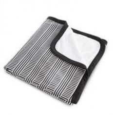 Sweet and sophisticated, the Black and White Crib Bedding Collection from Oilo Studio surrounds your little one with serenity and style, right from the start. The Cuddle Blanket is soft cotton jersey on one side reversing to plush chenille on the other. White Crib Bedding, Black Blanket, Black And White Baby, Baby Swaddle Blankets, White Nursery, Stroller Blanket, Modern Kids, Cuddling, Baby Kids