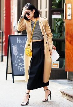 On Hudgens: Komono Dreyfuss Sunglasses ($60); Michael Stars Long Sleeve Striped Crop Top ($88); Blaque Label culottes; Chloé bag; Saint Laurent Jane Sandals ($795).