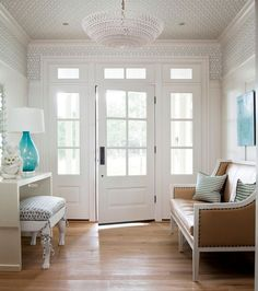 great entry way and that lamp is the perfect pop of color