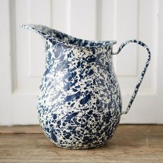 "Inspired by vintage enamel finds, this classic pitcher is topped with a speckled finish.- Metal, enamel- Dishwasher safe- Imported9""H, 5.35""W, 9.25""L"