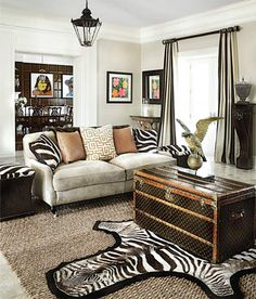 Love the stripe introduced in the area rug, pillows and stools. #zebrastripe http://www.aftershocksinteriordecorating.com