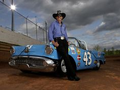 Richard Petty with a restored version of his first race car.