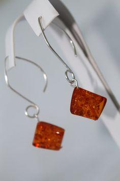 Amber dangle earrings $6