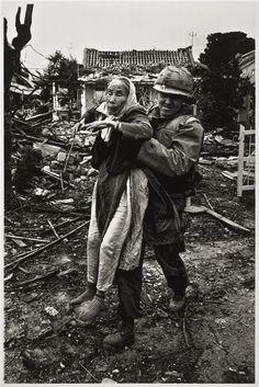 US Army chaplain evacuates an elderly Vietnamese woman, Tet Offensive, Hué, South Vietnam, February 1968