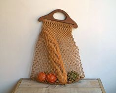 I wish I knew how to make this net pattern.   Vintage Crochet Net Tote Bag, Market Bag, Beach Tote. $22.00, via Etsy.