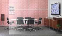 Conference room with Alexander Girard print and Eames softpad chairs
