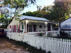 Old wooden cottages of Key West, FL. Historic abodes - cottages as art. Gingerbread porches and tropical gardens. Stuff that storybooks are written about. Key West Map, Key West Cottage, Wooden Cottage, Victorian Cottage, Tropical Gardens, Cottage Style Homes, Old Town, Porches, Cottages