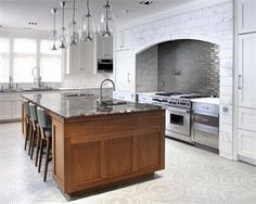 Vent hood and range in brick Kitchen by Karen Williams http://www.homeportfolio.com/SlideShow/15-winning-kitchen-designs/family-flair#slide