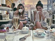That's the spirit! Selena Gomez shared an Instagram photo of herself and a gal pal indulging in afternoon tea at The Savoy in London on Saturday