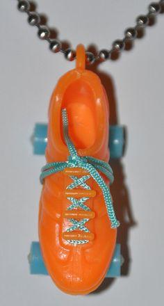 $15 - Vintage 1975 Orange Roller Skate Necklace
