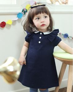 love the second ruffly sleeve detail and navy and white is always cute