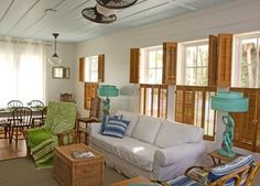 Beach Cottage Shutters - like green chair, turquiose lamps, coffee table, rug, and couch.  Great look combining bright colors