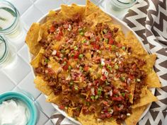 Chili Dog Nachos : Rachael's meaty nachos for game day are ready in just 25 minutes.
