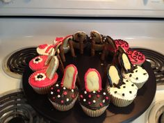 High Heel cupcakes!  super fun!  Milano cookies as the sole and those chocolate filled cookie sticks (can't remember what they're called) for the heel.