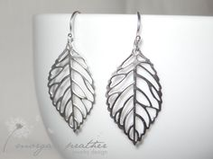 Delicate Leaf Dangle Earrings - Cute Simple Minimal Leaf Earrings in Silver - Perfect Gift - morganprather. $23.00, via Etsy.