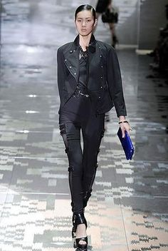 Fergie wearing Gucci Pants + Halter Top.