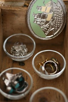 use small bowls and votives from IKEA to store / display jewelry
