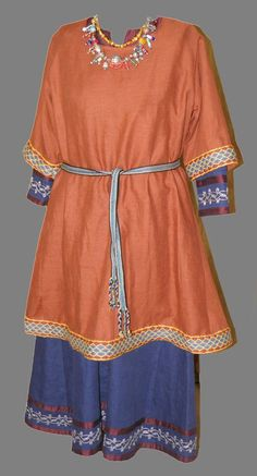Sam's Viking Dress - Over Tunic & Inspiration Necklace. Belt and over-Tunic has genuine hand tablet woven trim from silk and wool threads. Blue Linen Under-Dress has hand embroidered metallic gold silk threads with bands of Dupioni silk trim.