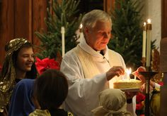 Christmas Eve~ pastor lights a birthday cake for Jesus during the Christmas Eve family service and children's pageant