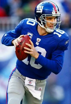Eli Manning of the New York Giants. Manning is the son of former New Orleans Saints quarterback Archie Manning. He has won two Lombardi Trophies so far in his career, both with the Giants. New York Giants Football, Nfl Football Players, Football Helmets, Football Pics, Manning Football, Giants Players, School Football, Peyton Manning, Football Boots