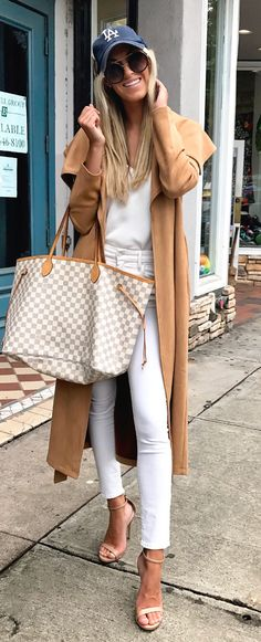 #fall #outfits women's white scoop-neck shirt, white fitted denim jeans, pair of brown open-toe ankle-strap heeled shoes, brown cardigan, and Damier Azur Louis Vuitton Neverfull outfit