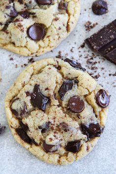 Chocolate Lover's Chocolate Chip Cookie Recipe on twopeasandtheirpod.com Chocolate chip cookies with chocolate chips, chocolate chunks, and grated chocolate. These are the BEST chocolate chip cookies!