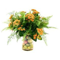 """Bring garden-inspired elegance to any room with this lovely faux kalanchoe arrangement, showcasing lush blooms and leaves nestled in a vase with lifelike apples.  Product: Faux floral arrangementConstruction Material: Silk, polyester, glass and acrylicColor: Orange, red and greenFeatures:  Includes faux kalanchoe and applesHandmadeDimensions: 19"""" H x 22"""" DiameterCleaning and Care: For indoor use only"""