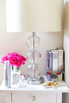 Display your favorite necklace draped over a stack of books.