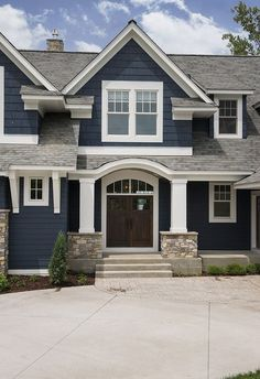 Color Navy exterior paint color with white trim. Navy exterior paint color is Benjamin Moore Hale Navy. Navy exterior white trim home ideas. Navy homes. Navy home Ideas. Navy home white trim paint color ideas.