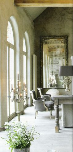 Love the wall texture and color, vaulted ceiling, wood beams, antiqued mirror and console table