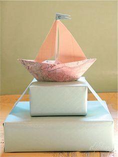 Origami sailboat as placecard?  Different color sails or boat body to indicate meal choice.