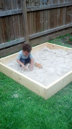 DIY sandbox... and the little boy even looks like Olen!
