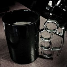 Knuckle Duster Mug - These large porcelain novelty mugs with knuckle duster / brass knuckle shaped handles will ensure your coffee packs a serious punch. Approximately 20 oz.