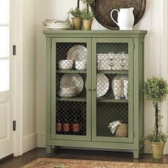Laurel Display Cabinet at Ballard Designs... I think I could copy this with a DIY and use it as storage and a bookshelf.  I just need to find a small cabinet at a garge sale or Craigslist, refinish it with paint and distressing, and I want to replace the display opening with chicken wire..it'll be super cute!  Maybe add some cute knobs from Hobby Lobby too!