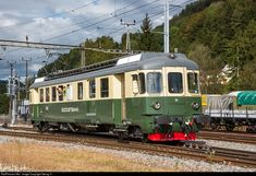 """Former Südostbahn high power (2140 HP) railcar BDe 4/4 # 80 """"Einsiedeln"""", since 2010 owned and operated by association Depot und Schienenfahrzeuge Koblenz (DSF) with name and blazon of """"Koblenz"""", as new in Bauma today. The high power railcar was built as ABe 4/4 # 71 in 1959 for the Südostbahn, later rebuilt as BDe (baggage instead of first class compartment) and is now rebuilt and new painted as historic vehicle BDe 4/4 80 from the 1980'."""