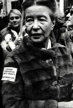 "Simone de Beauvoir during a women's demonstration in Paris. The text in her arm says: ""Free and costless abortion ..."