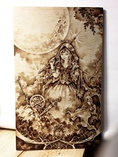 """[Tarot Card Major Arcana """"1. The Magician""""] Pyrography on birch plywood. 145x240mm Prismacolor colored pencil, white color."""