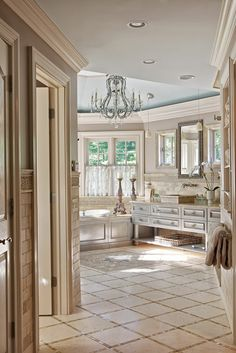 Barbara Fina. This Master Bathroom entrance started with a directive to the architect for the redesign of this house that one wall had to go at a 45 degree angle. Interior Design