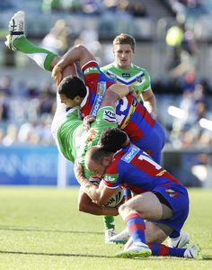2014 NRL Round 6 Canberra Raiders V Newcastle Knights: Brett White of the Raiders is tackled by Jarrod Mullen and Beau Scott of the Knights during the round 6 NRL match between the Canberra Raide.