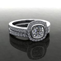 Wedding band with Diamond centre and Diamond sides Style: Decorative Setting, Side Channel, Cathedral, Halo
