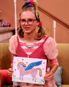 """LOL! Taylor Swift donned braces and pigtails to appear as nerdy Natalie alongside Jimmy Fallon in his hilarious """"Ew!"""" segment on the Tonight Show. Watch the video!"""