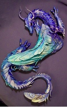 So vibrant! I would love this 3D look of a dragon crawling on me as a tattoo :D