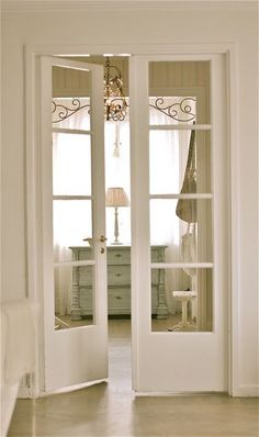 white French doors match a shabby chic interior and let ght light in
