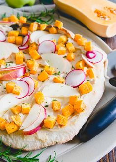 Try a healthier twist to traditional cheese pizza with this hummus pizza! Topped with roasted rosemary butternut squash, crunchy tart apples and thinly sliced radishes, it's a delicious vegetarian spin for fall.