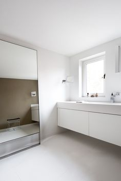 Brilliantly simple bathroom design. Absolutely love the huge, floor-to-ceiling mirror.